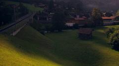Paning shot of Lauterbrunnen, Switzerland at dawn Stock Footage