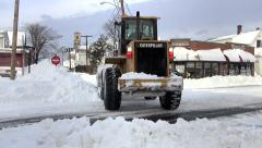 Tractor front loader removes snow on street Stock Footage