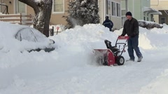 Snow blower plows drifts from street , sound Stock Footage
