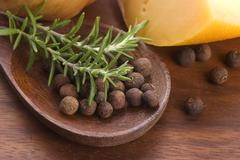 Allspice with fresh rosemary, cheese and onion Stock Photos