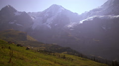 Footage of valley and Swiss Alps in the summer Stock Footage