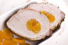 Roasted pork loin with dried apricots - stock photo