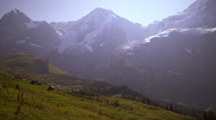 Footage of valley and Swiss Alps in the summertime Stock Footage