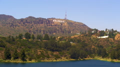 Stock Video Footage of Long distance static shot of the Hollywood sign with a body of water in the