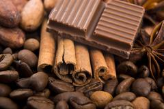 Chocolate with coffee beans, spices and cacao Stock Photos