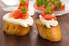 Bruschetta with mozarella and tomatoes Stock Photos