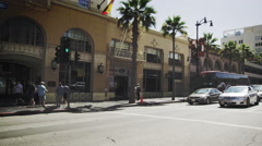 Slow motion dolly shot of buildings along Hollywood Blvd. in California Stock Footage