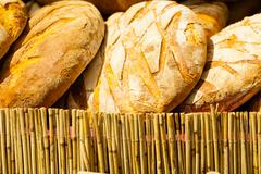 Stock Photo of many brown rustic fresh rye bread loaves