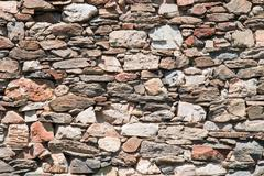 Dry stone wall made of irregular shaped stones Stock Photos