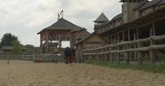 Actors on The Horses Are Riding to The Stable, Stadium, Wooden Buildings Stock Footage