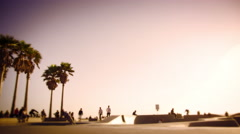 Sunset shot at Ocean Front Walk near Venice Beach, California in slow motion Stock Footage