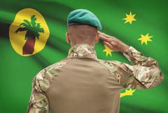 Dark-skinned soldier in hat facing national flag series - Cocos (Keeling) Isl Stock Photos