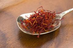 Stigmas of saffron in spoon Stock Photos