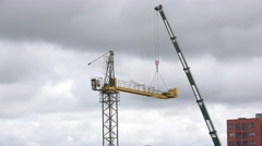 Disassemble crane on cloudy sky background. 4K Stock Footage