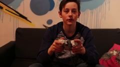Teenager Boy Playing with Joystick on Console - stock footage