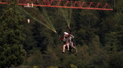 Shot of two people tandem paragliding in Switzerland Stock Footage