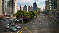 A view of a Chinese city with office buildings and orderly traffic stopping and - stock footage
