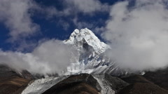 Time-lapse of clouds passing in front of a Himalayan peak. Stock Footage