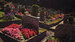 Paning shot of a graveyard and church at Kloster, Switzerland Stock Footage
