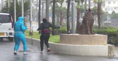 Women Blown Down Street By Powerful Hurricane Wind Stock Footage