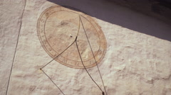Static shot of a sundial on a wall in Switzerland Stock Footage