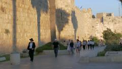 Multi-ethnic crowd walking along the Jerusalem Walls (4k) Stock Footage