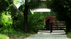 The gates to the courtyard house in the woods Stock Footage