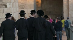 Slow motion of Orthodox Jews walking in Jerusalem Stock Footage
