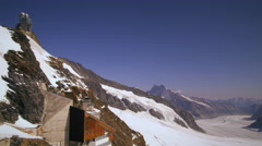 Static shot of the alpine mountain range taken from a base camp in Switzerland Stock Footage