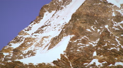 Tilting shot of Swiss alp peak Stock Footage