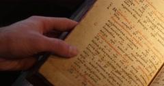 Man's Hands on Old Book Paterik of Kiev-Pecherska Lavra Old-Slavic Writing - stock footage