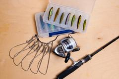 Fishing rod and reel with box for baits. Stock Photos
