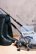 Fishing rod and reel with box for baits. - stock photo