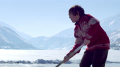 Close up of a boy practicing hockey at an outdoor ice rink. - stock footage