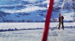 Young boy skating towards a hockey goal. - stock footage