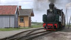 Narrow gauge steam railroad train arriving station Stock Footage