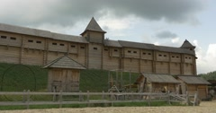 Ancient City Reconstruction, City Wall with Embrasures, Wooden Buildings, Stock Footage