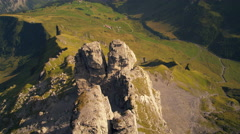 Descending dolly shot of rock formation near the Swiss alps Stock Footage