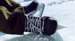 Close up of a hockey skate being tied at an outdoor rink. Stock Footage