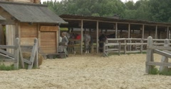 Two Horses and Actors in a Stable Under The Shed, Wooden Fence, Sandy Stadium Stock Footage