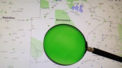 BOTSWANA seen trough a green magnifying glass Stock Footage