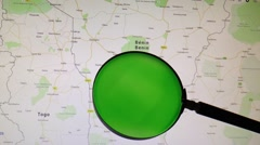 BENIN seen trough a green magnifying glass Stock Footage