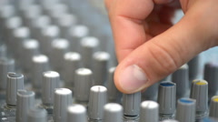 Hand adjusting audio mixer buttons Stock Footage