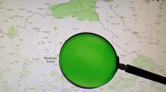 BURKINA FASO seen trough a green magnifying glass Stock Footage