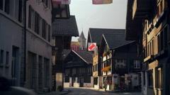 Cars traveling down Hauptstrasse road, Brienz, Switzerland Stock Footage