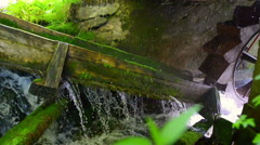 Stock Video Footage of Close up on a rustic hydroelectric generator in mountains