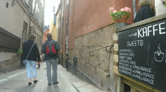 Narrow Street in StockholmOld Town, Gamla Stan with cafe Stock Footage