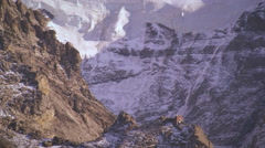 Snowy mountainside of Swiss alps, small building Stock Footage