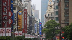 Chinese store name signs at Shanghai Nanjing Road in Shanghai, Chi - stock footage