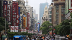 Crowded visitors and travelers walking at Shanghai Nanjing Road in Shanghai, Chi Stock Footage